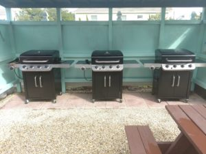 3 Gas BBQ Grills With Side Burner And BBQ Utensils By The Grills